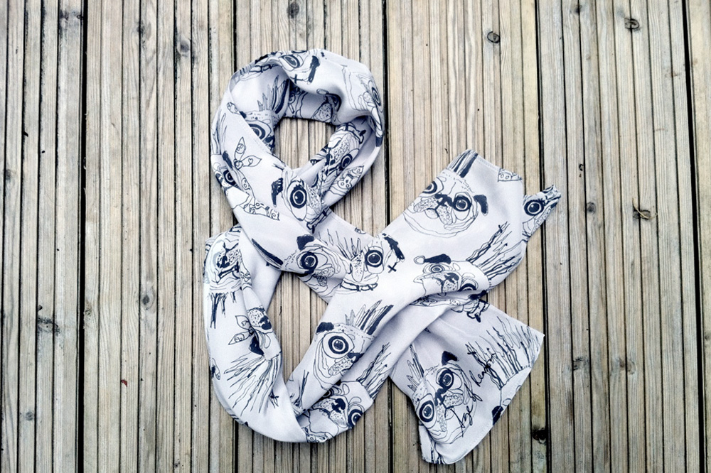 Age of Reason Studios, Ali Taylor's scarf ampersand